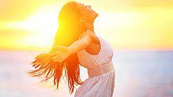Enjoyment – free happy woman enjoying sunset